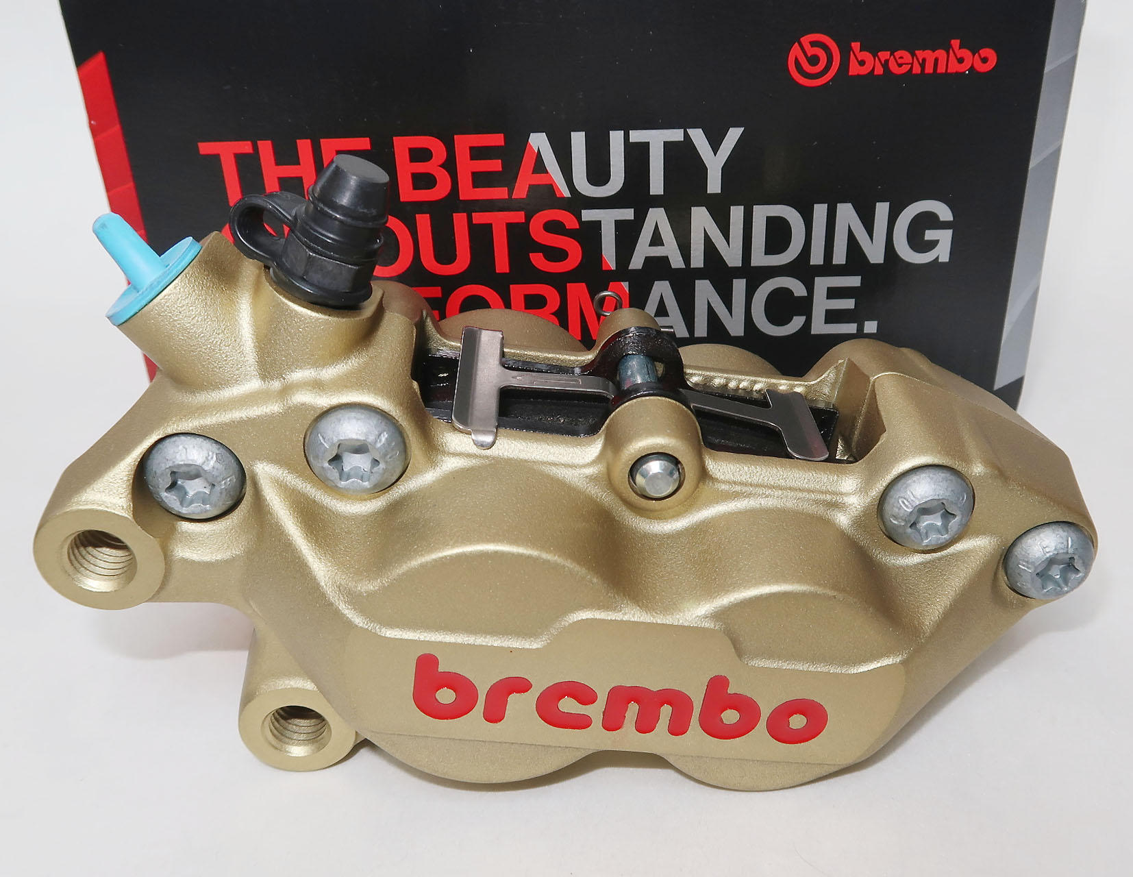 Brembo Caliper P4 30/34C, gold, left side, Brembo Logo red